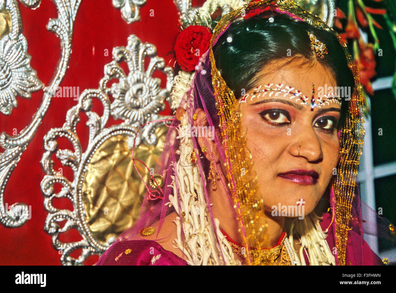 Bride looking at camera ; a Bengali marriage ceremony ; India Stock Photo