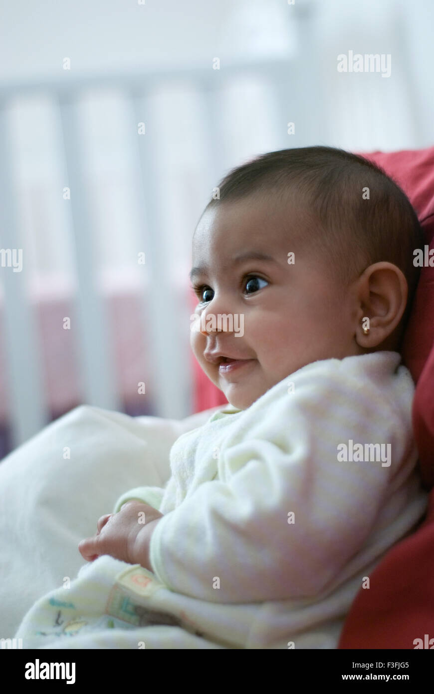 Baby Girl Namya ; two months old ; face ; expressions ; emotions and moods MR - Stock Image