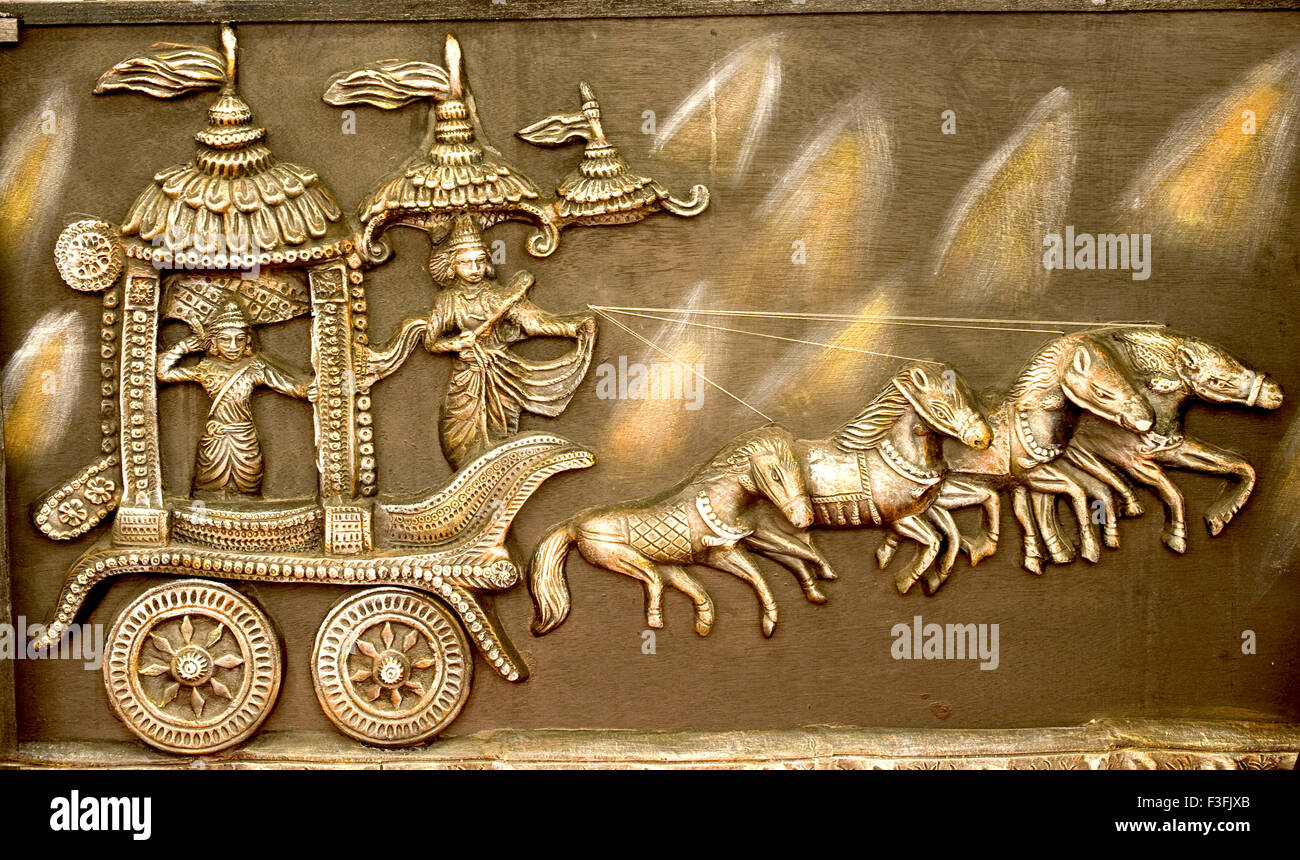 Terracotta panel of Mahabharata battle where lord Krishna and Arjuna are in the chariot ; India - Stock Image