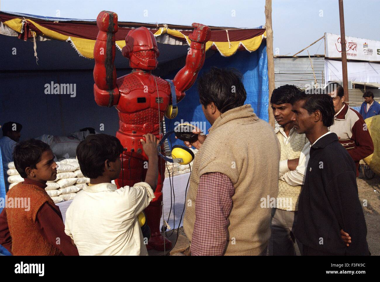 Pilgrims listen to astrology from a road side robot during the Ardh Kumbh Mela ; ; ; India - Stock Image