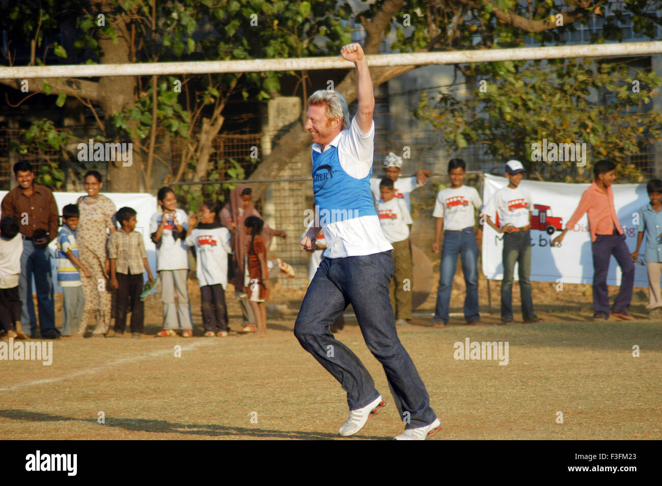 Boris Franz Becker visits a football program organized by an NGO Magic Bus in Bombay now Mumbai ; Maharashtra ; - Stock Image