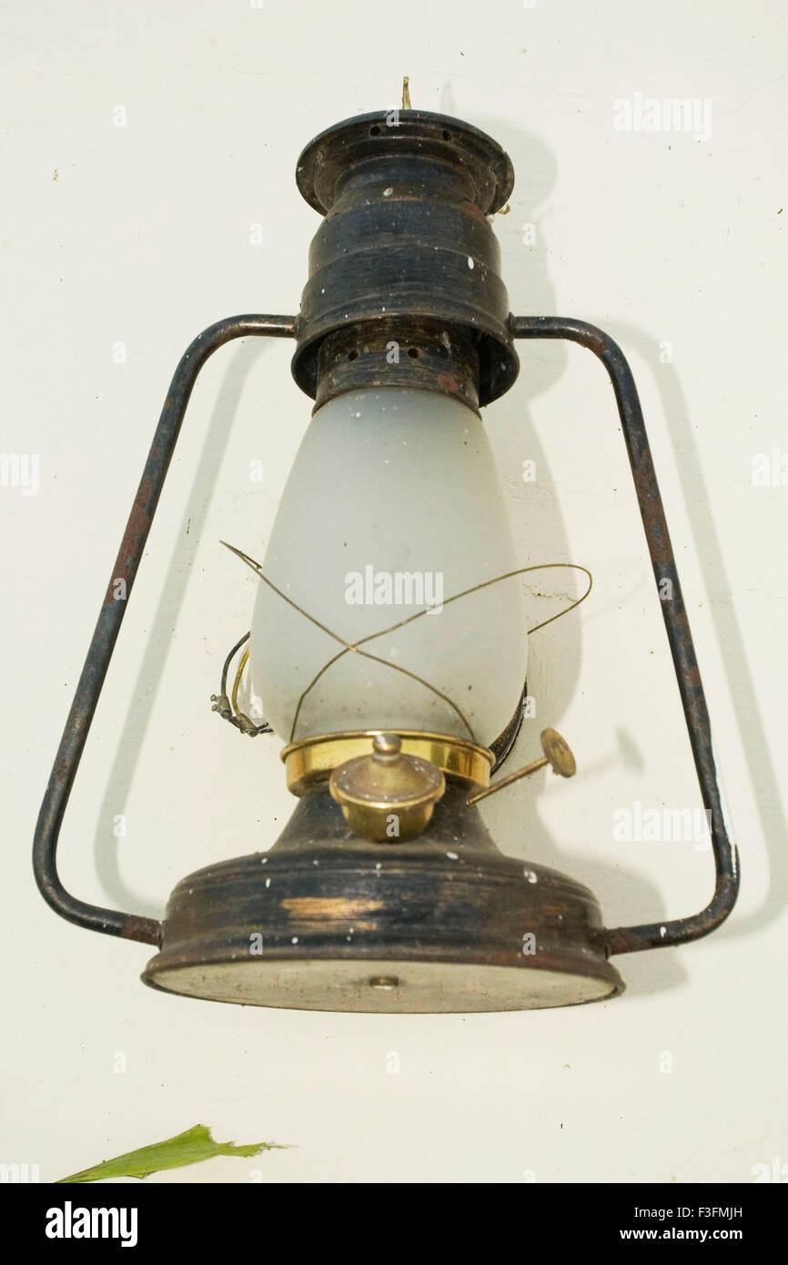 Lantern hanging on wall - Stock Image