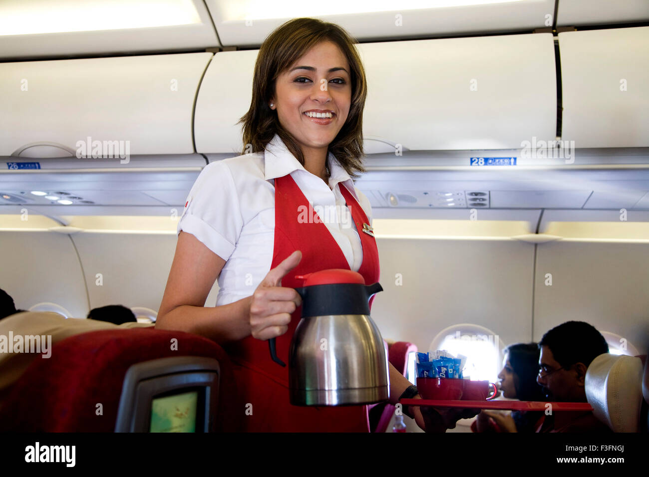 Air Hostess serving tea coffee in kingfisher deccan flight airbus A320 Mumbai India - dkk 148566 - Stock Image