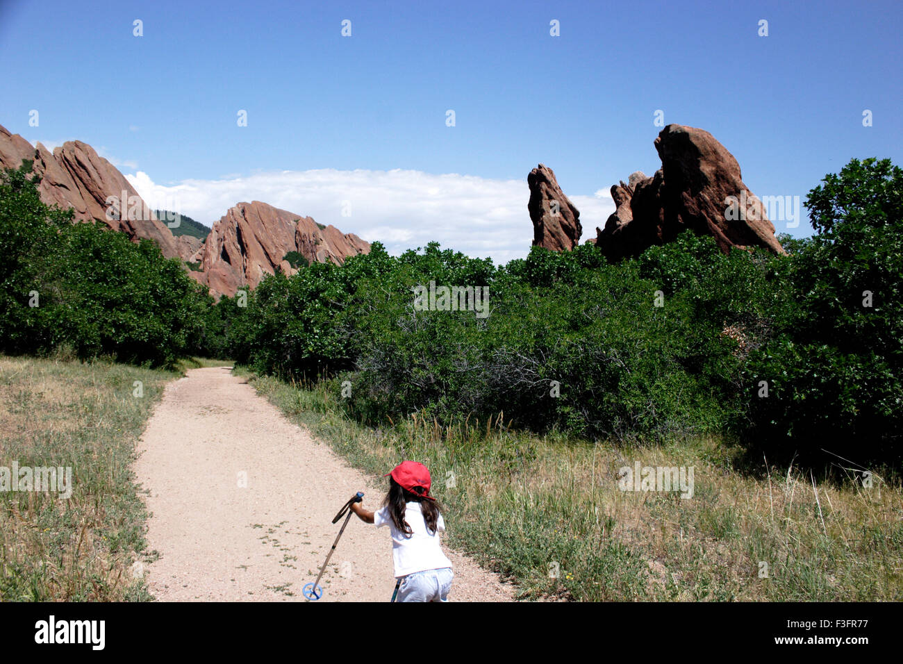 Three year old girl wants to reach top of hill MR#0543 - Stock Image