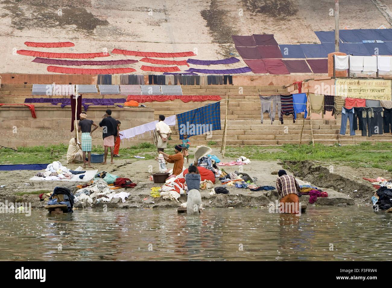 Dhobi men on Ganga river at Varanasi ; Uttar Pradesh ; India - Stock Image
