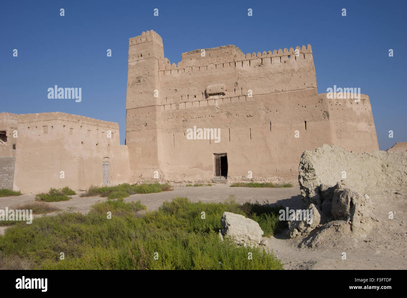 Ornate ancient adobe fortress in a town in the Sultanate of Oman, a safe, friendly Gulf State holiday destination Stock Photo