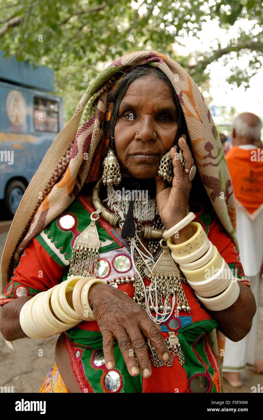 A Banjara woman (among the most richly attired of the nomadic community) at Tirumalai ; Andhra Pradesh ; India - Stock Image