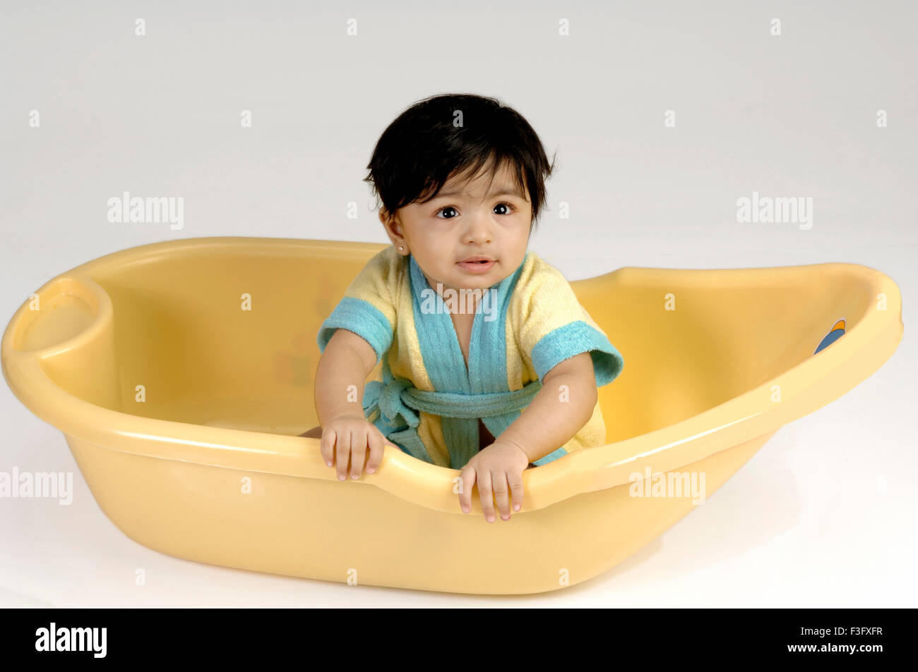 Baby In Yellow Bath Tub Stock Photos & Baby In Yellow Bath Tub Stock ...
