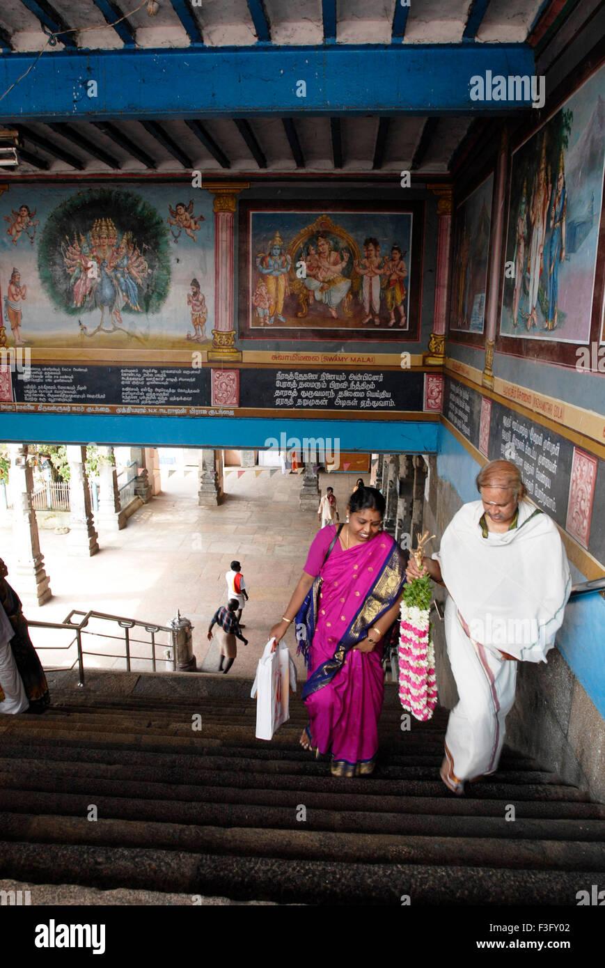 Devotees climbing up 60 steps ; Swamimalai ; Tamil Nadu ; India - Stock Image