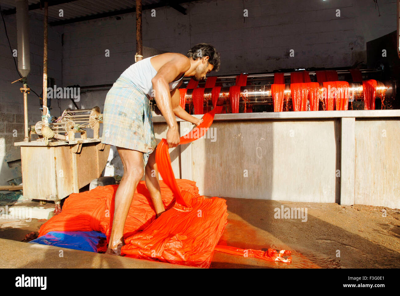 Fabric dyeing ; winch dyeing is a old method ; garment industry ; Tirupur ; Tamil Nadu ; India - Stock Image