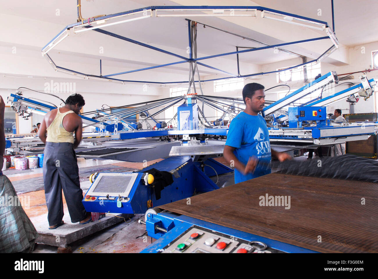 Automatic fabric screen printing machine in a garment industry Stock