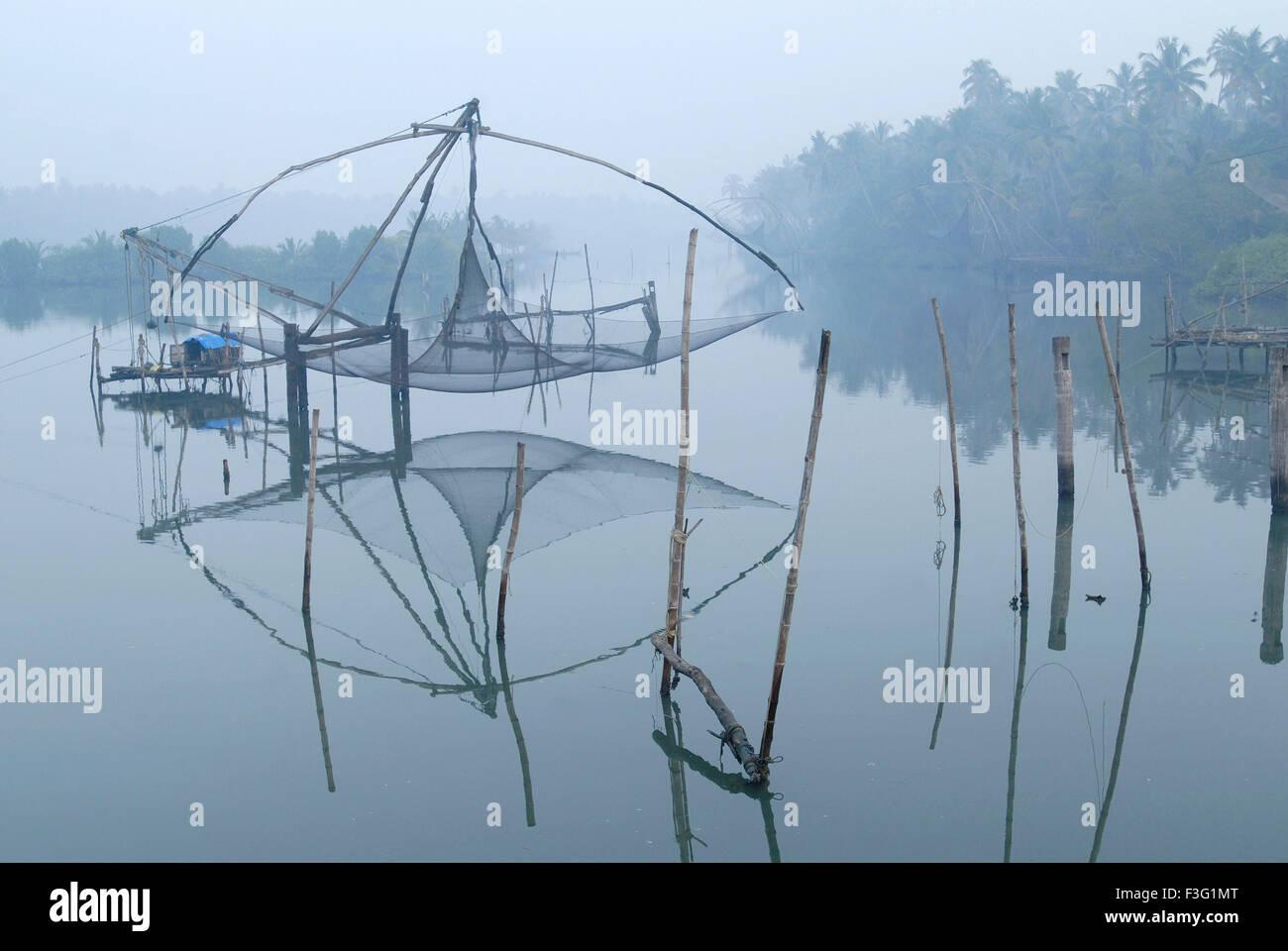 The Chinese fishing net ; cheena vala fishing technique ; cochin kochin ; kerala ; India - Stock Image