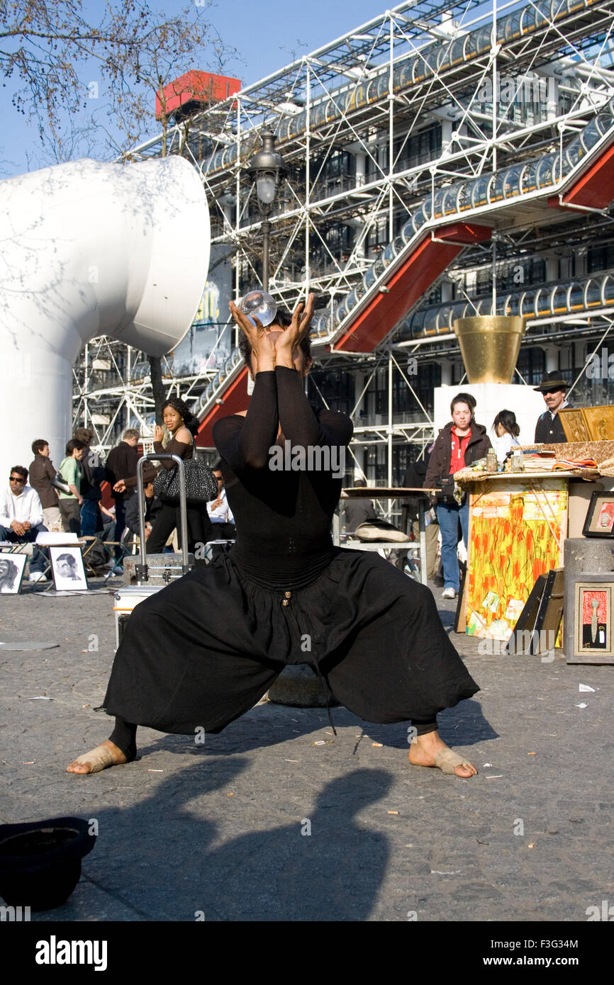 Performing art on street Outside Pompidou Centre building Modern Art Museum ; Paris ; France ; Europe - Stock Image