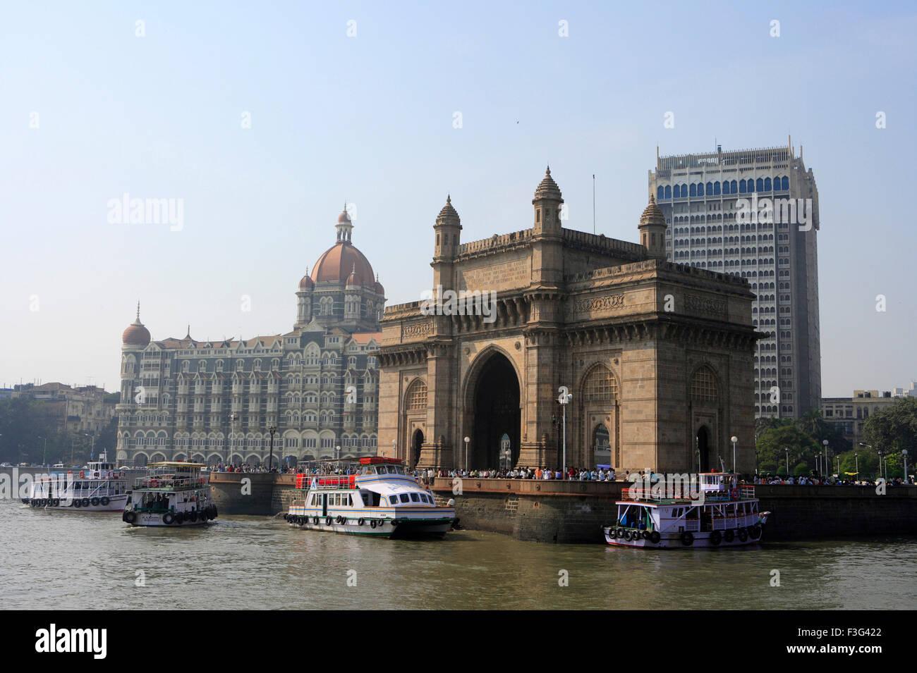 Gateway of India and Taj Mahal Hotel ; ferryboats in sea ; Bombay Mumbai ; Maharashtra ; India - Stock Image