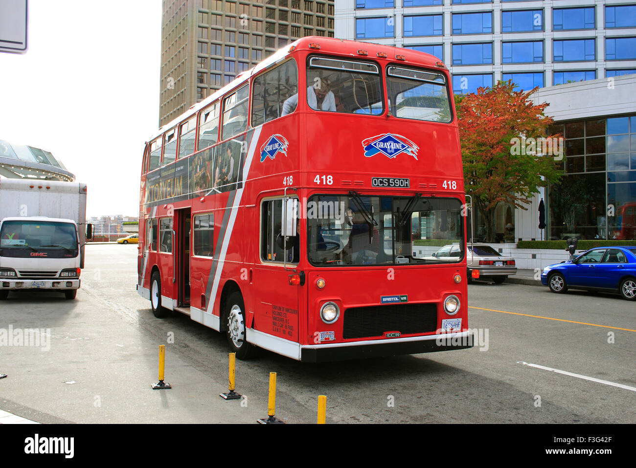 Red double decker bus on street of Vancouver bc ; Canada - Stock Image