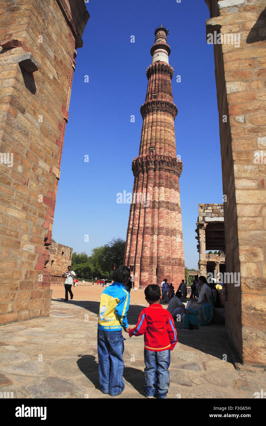 5d590c75a753 Boys watching Qutb Minar through arch built in 1311 red sandstone tower   Indo  Muslim art