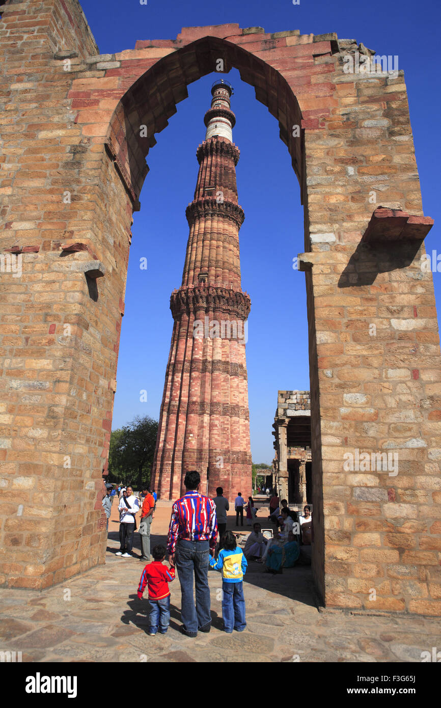 371f8f318da8 Father and sons watching Qutb Minar through arch built in 1311 red  sandstone tower   Indo