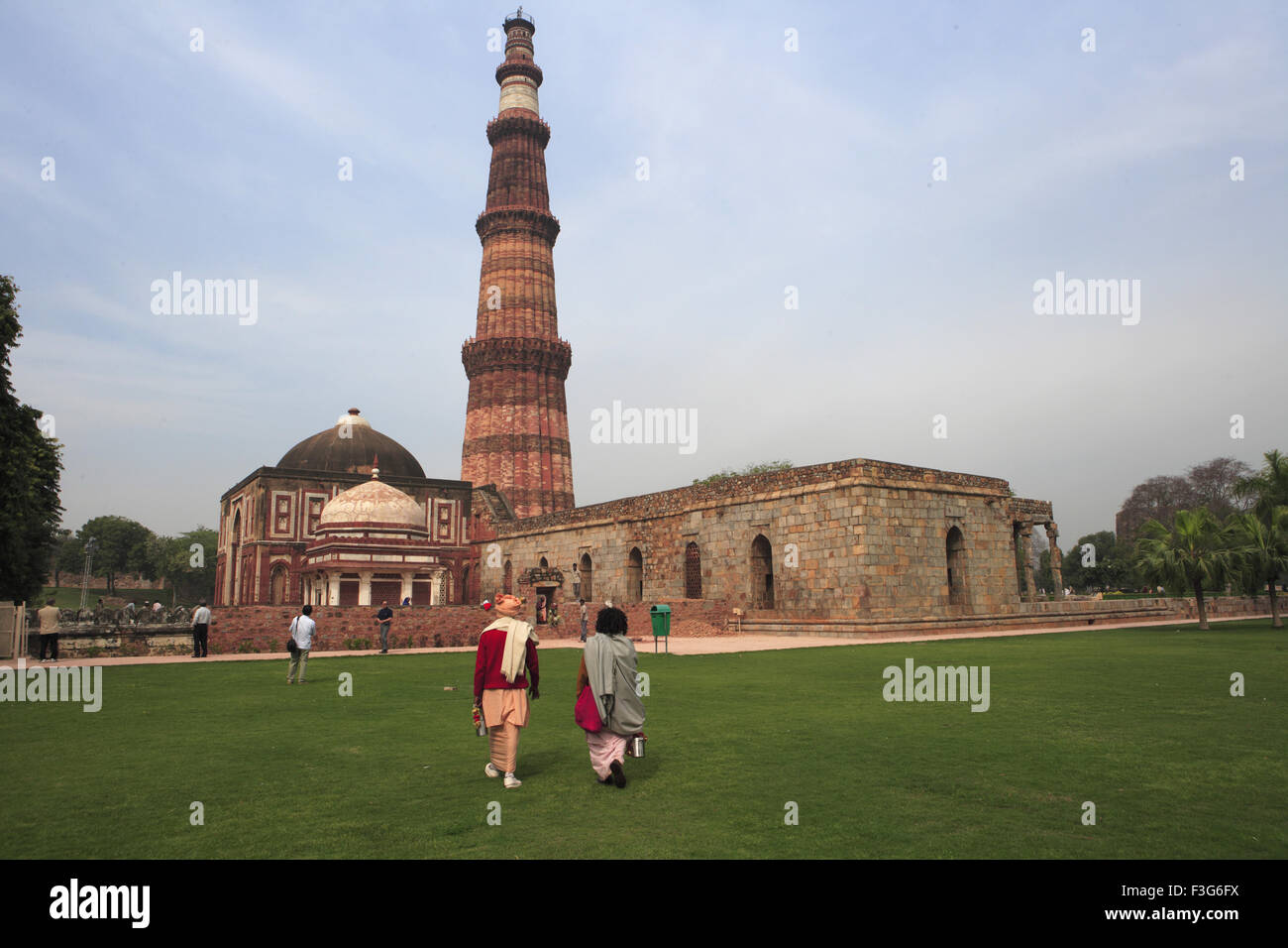 d1280db16220 Indian sadhus watching Qutb Minar  built in 1311 the red sandstone tower  Indo  Muslim