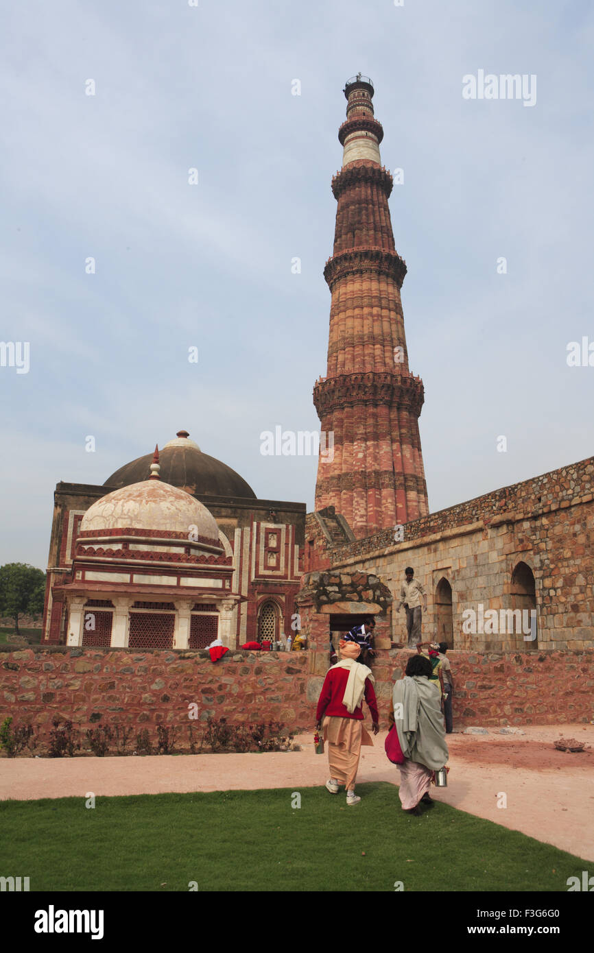 19e1dc0d9a5e Indian sadhu watching Qutb Minar built in 1311 red sandstone tower   Indo  Muslim art
