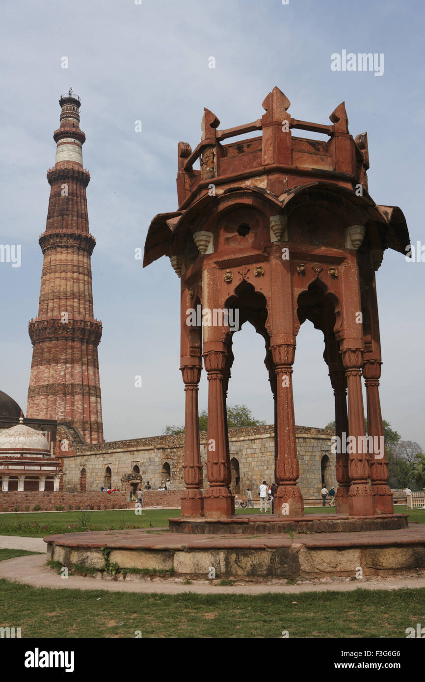 Smith's folly and Qutb Minar built in 1311 red sandstone tower ; Indo Muslim art ; Delhi - Stock Image