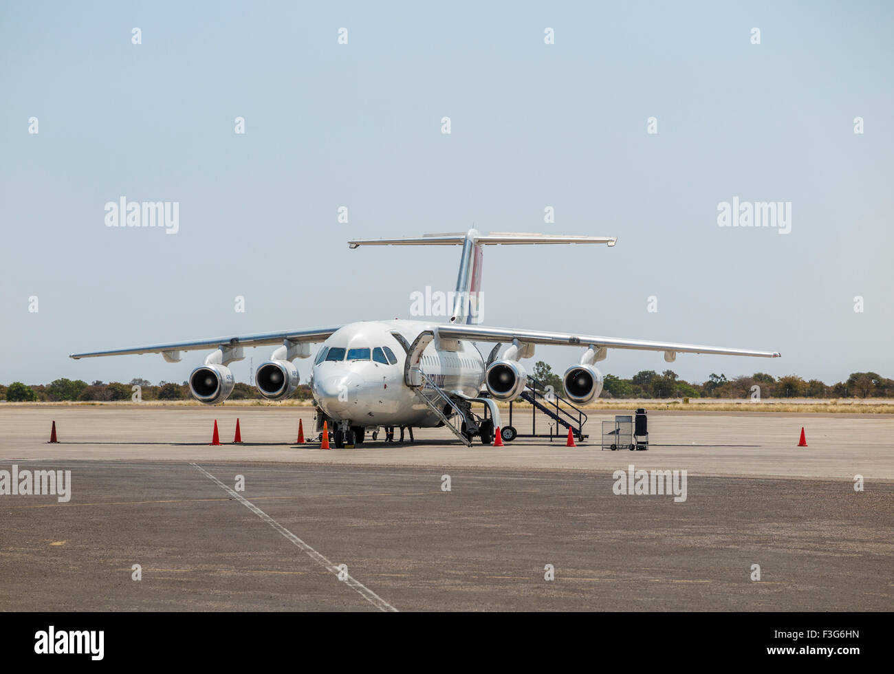 African passenger air travel to the Okavango Delta: Airlink Avro RJ85 at Maun Airport, Botswana, southern Africa - Stock Image