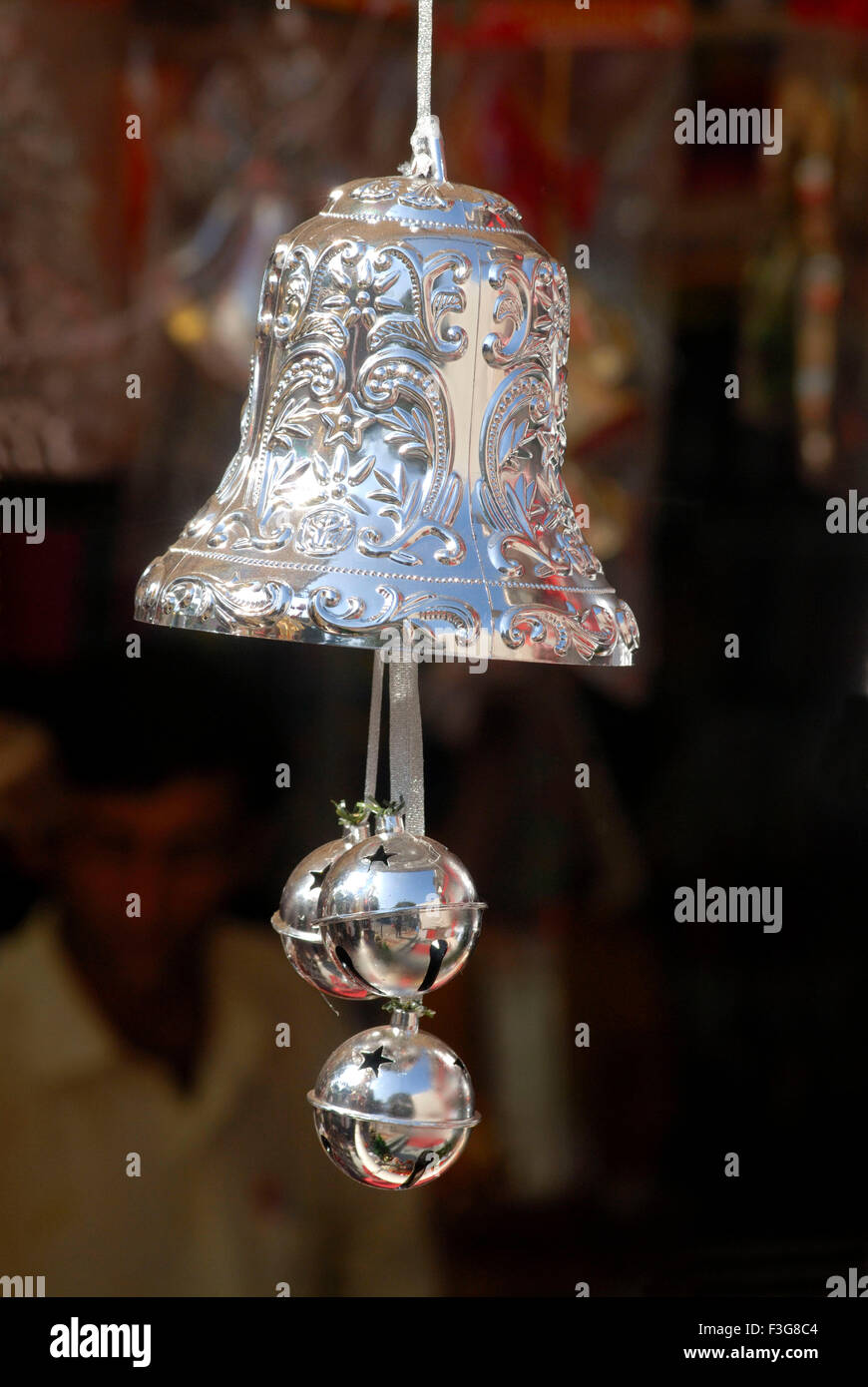 A shining Silver coloured Christmas bell kept for sell in shop at Borivali ; Bombay now Mumbai ; Maharashtra ; India - Stock Image