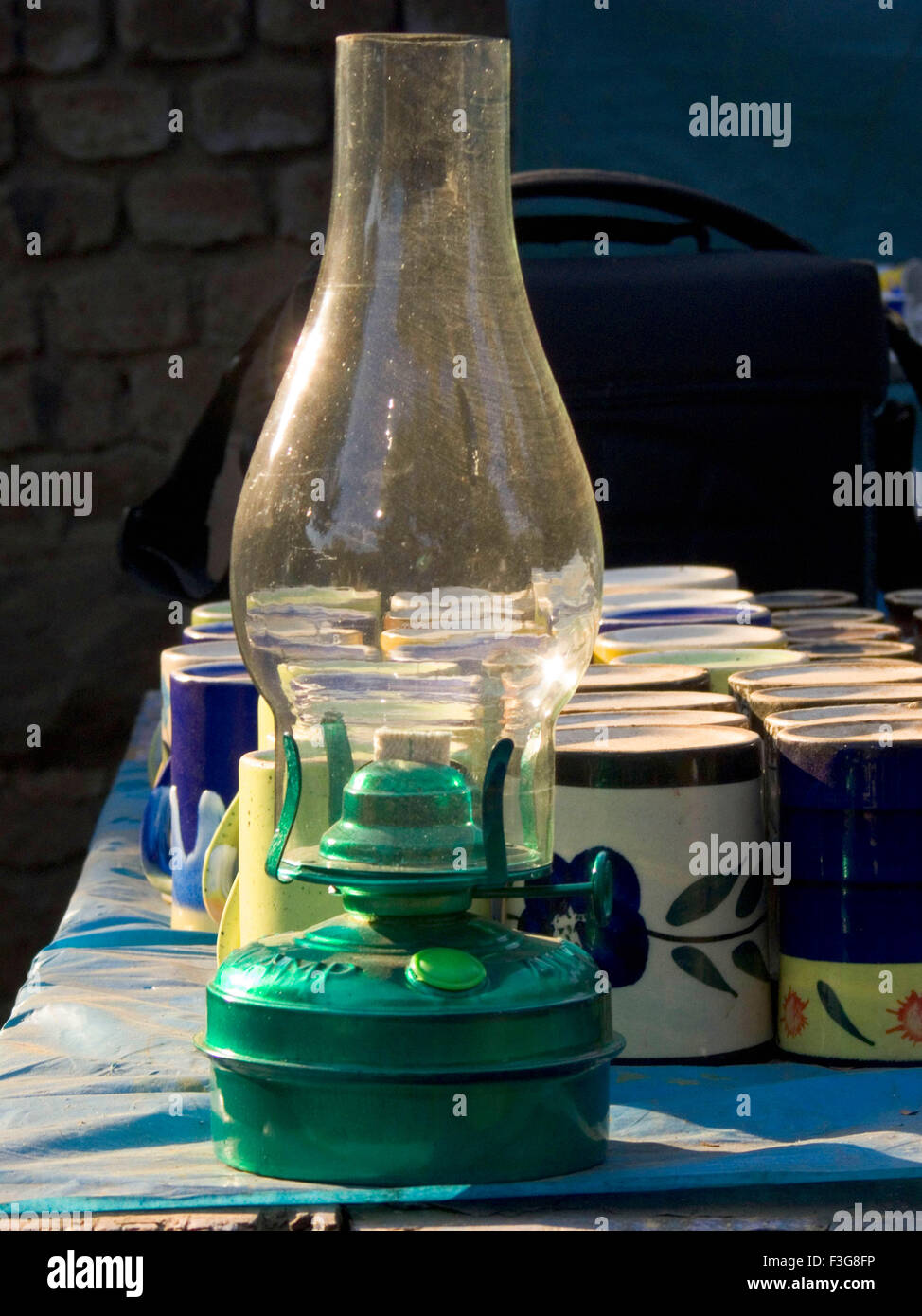 Small kerosene lamp a glass tube placed round flame of lamp local name Chimney - Stock Image