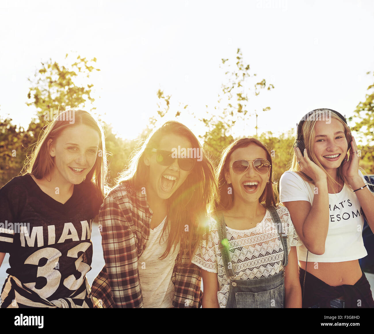Best friends laughing and having a good time on a summer day - Stock Image