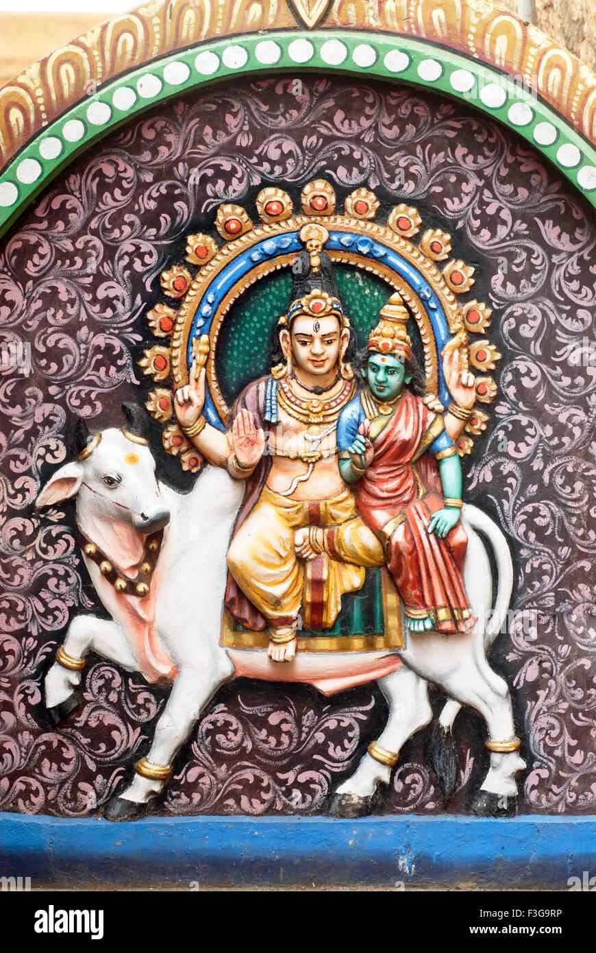 painted relief stucco figures lord Shiva Parvati riding Rishabha Shri Thayumanaswami temple Rock fort Tiruchirappalli - Stock Image