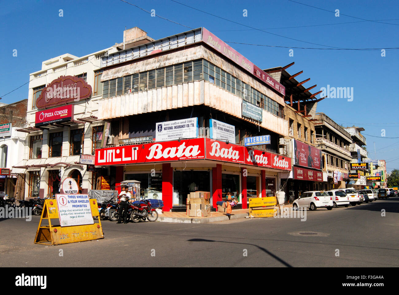 Big branded shops ; congested shop line at Jawaharlal Nehru Street ; main market area of Puducherry ; Union Territory - Stock Image