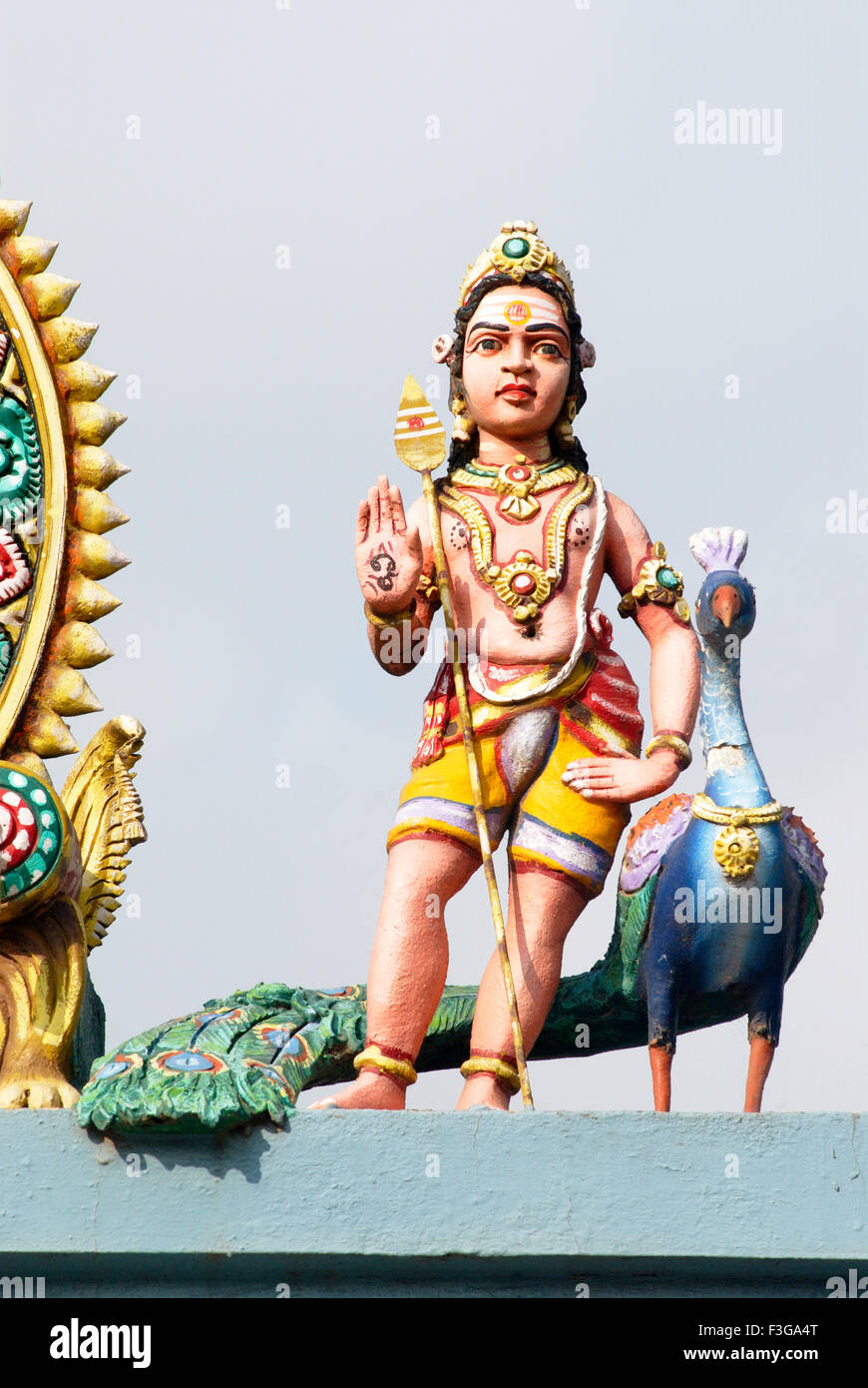 Colourfully painted stucco sculpture of Lord Kartikeya with his vehicle peacock over temple ; Thanjavur ; Tamil - Stock Image
