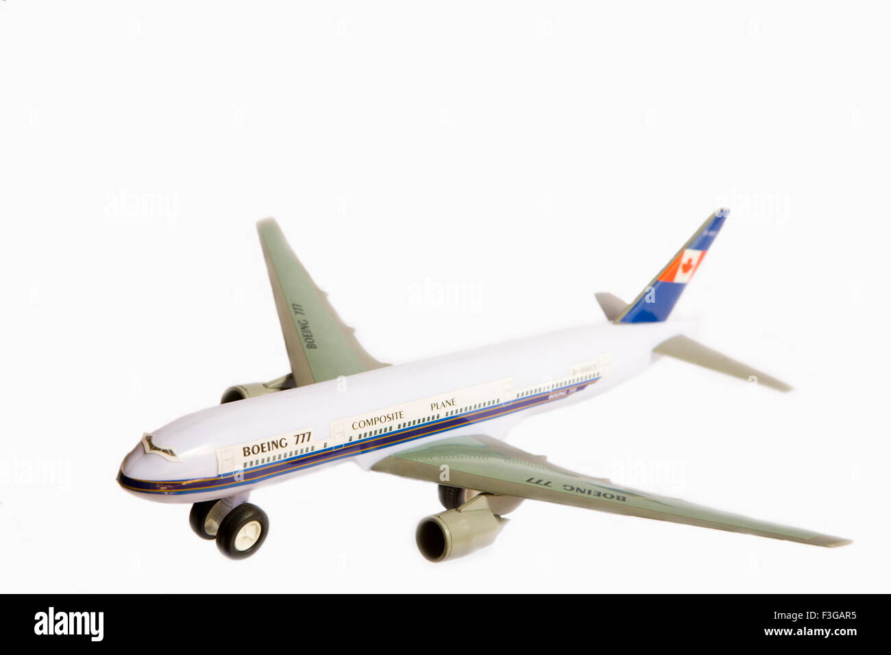 Toy aeroplane Boeing 777 on white background - Stock Image
