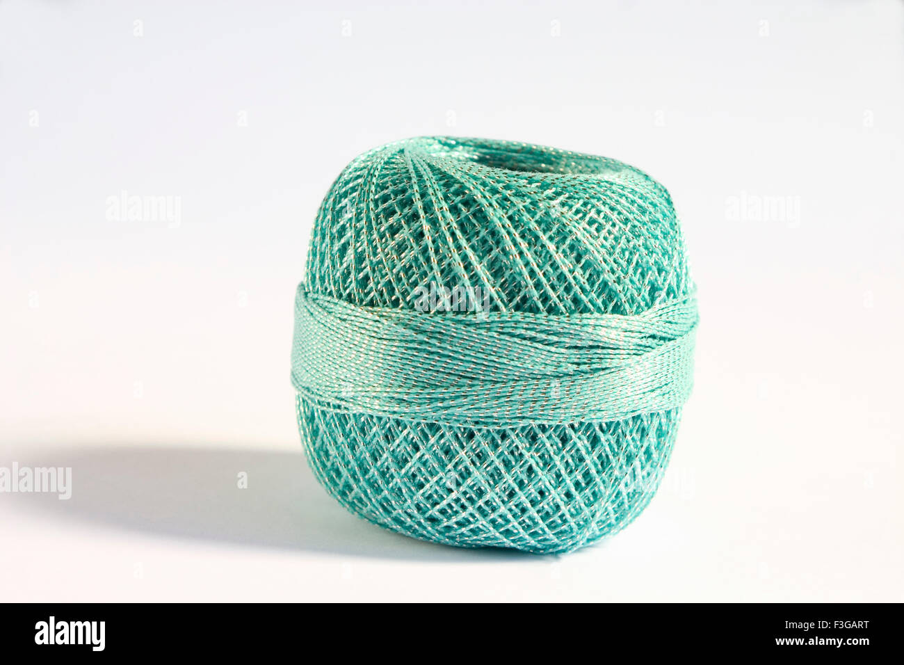 Concept ; alone circle one separate single sole round shape crochet cotton thread on white background - Stock Image