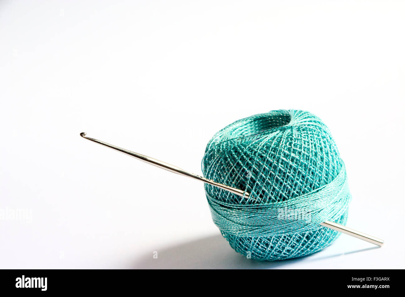 Concept ; alone circle one separate single sole round shape crochet cotton thread with knitting hooked needle - Stock Image