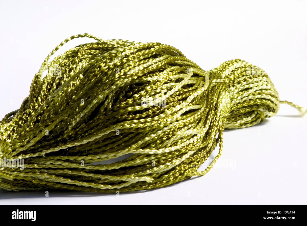 Concept ; crochet silky green thread on white background - Stock Image
