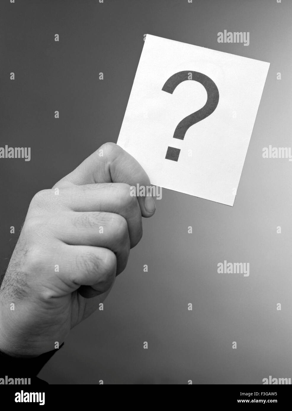 Hand & question mark - Stock Image
