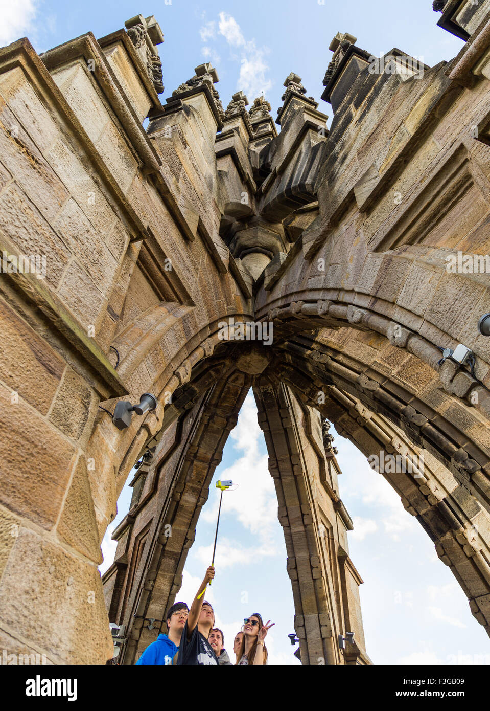 People taking a selfie at The National Wallace Monument on Abbey Craig, Stirling in Scotland Stock Photo