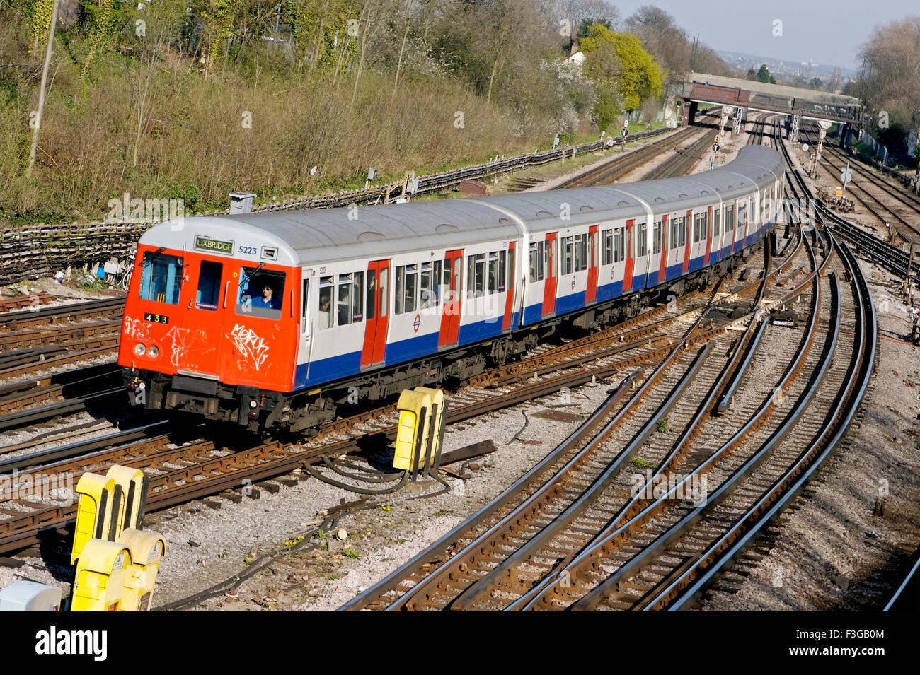 Tube train on tracks ; London ; U.K. United Kingdom England - Stock Image