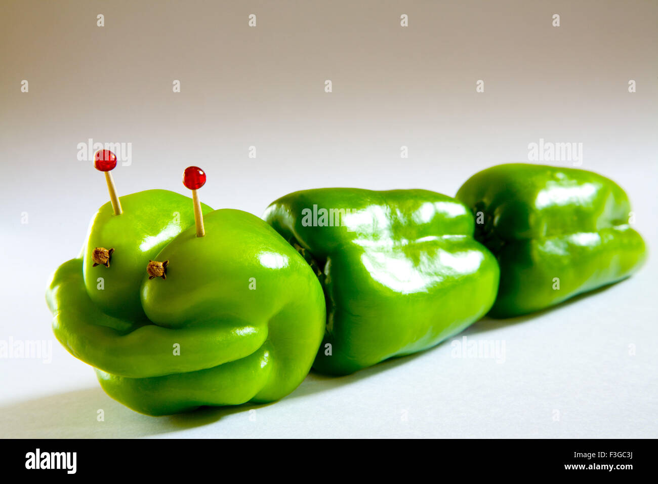 Alien capsicum concept creative modern toy on white background ; India - Stock Image