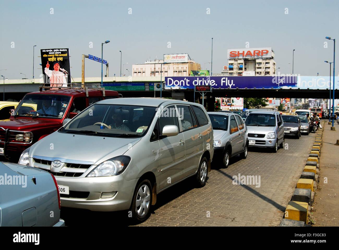 Traffic Jam Bombay Street Funny Ad Top to Solve Problem Stating Do Not Drive but Fly ; Bombay Mumbai Maharashtra - Stock Image