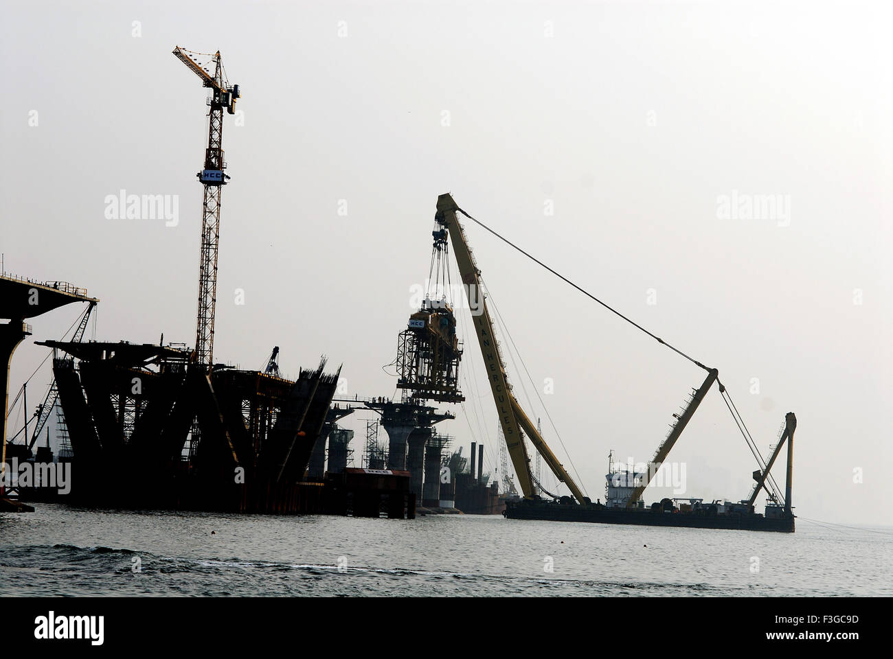 Asian Hercules floating crane capacity Hercules floating metric tones erecting Bandra Worli sea Bombay Mumbai Maharashtra - Stock Image
