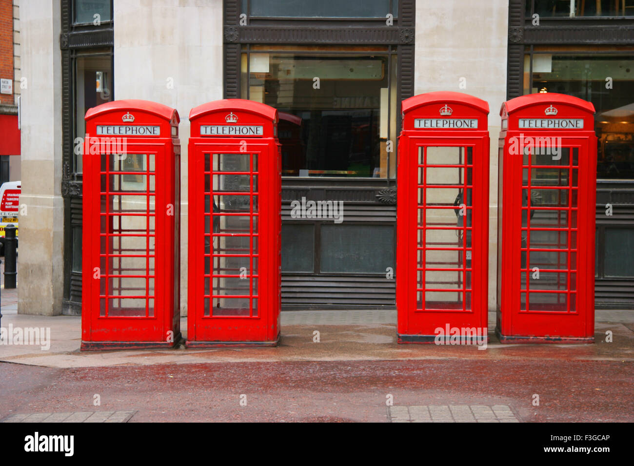Four telephones booths in row at Lester Square in London ; U.K. United Kingdom England - Stock Image