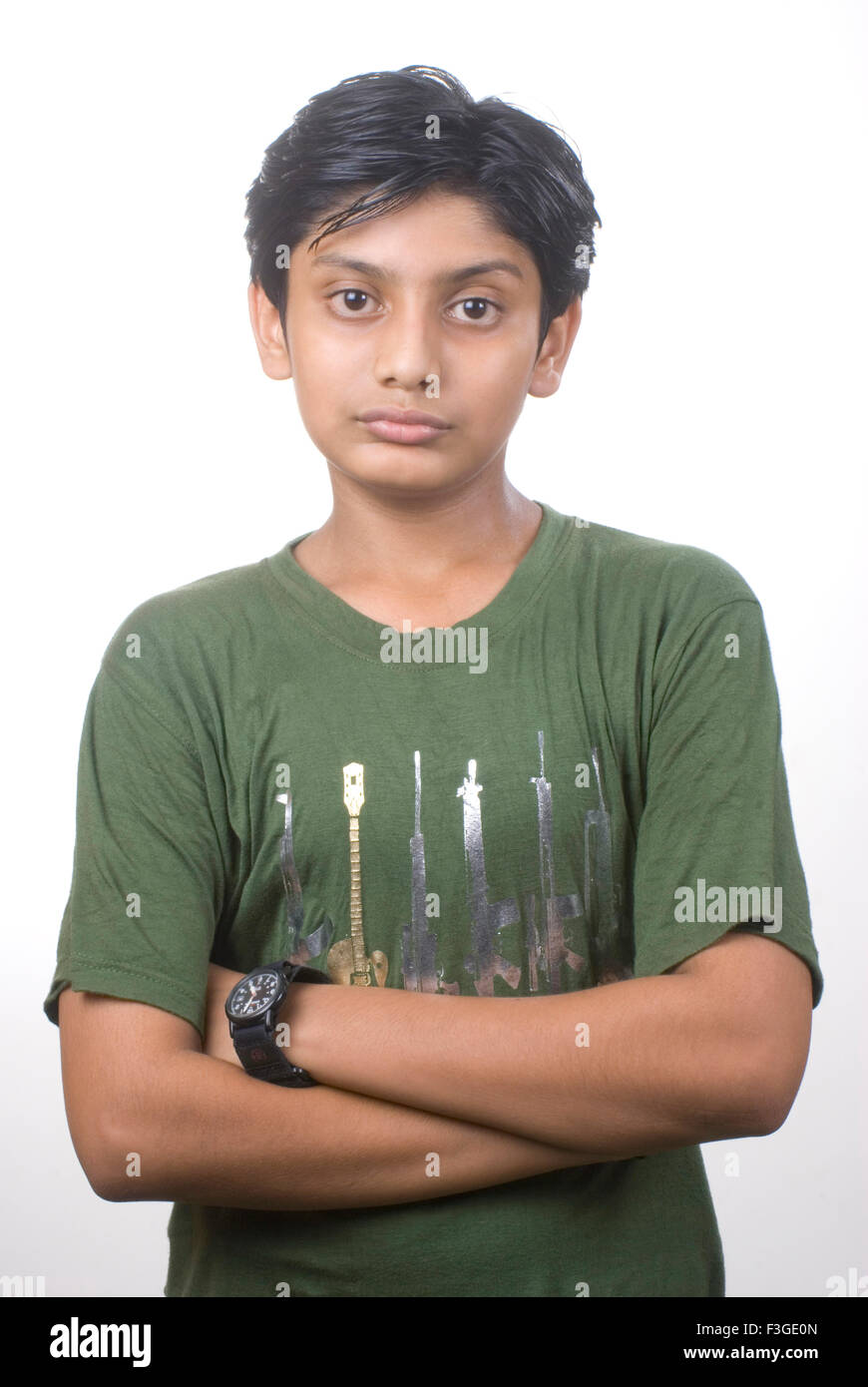 Teenager boy standing with crossed hands MR#733 - Stock Image