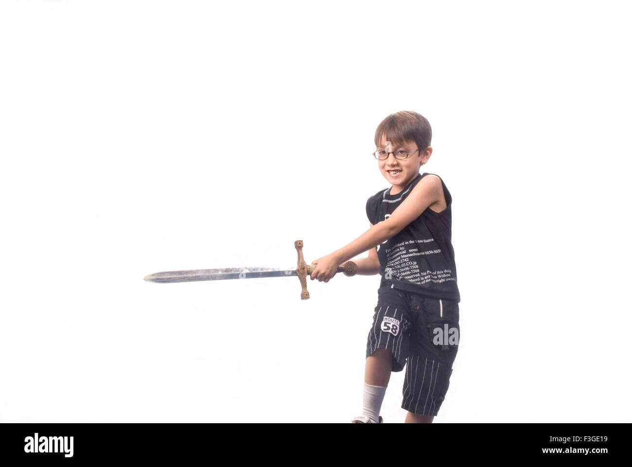 Teenager boy look alike Harry Potter playing with sword MR#733 - Stock Image