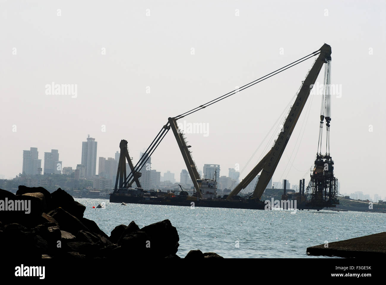 Asian Hercules 1600 Metric Tonnes Crane Carrying Load Standing in Mahim Creek ; Bandra ; Bombay Mumbai ; Maharashtra - Stock Image