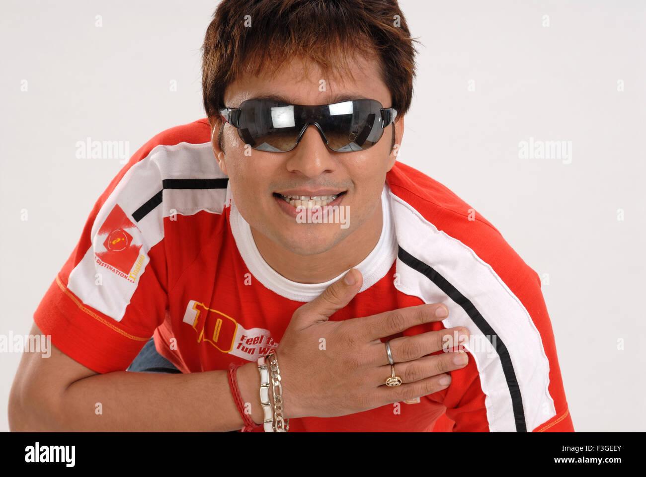 South Asian Indian man wearing sunglass ; Bombay Mumbai ; Maharashtra ; India MR#364 - Stock Image