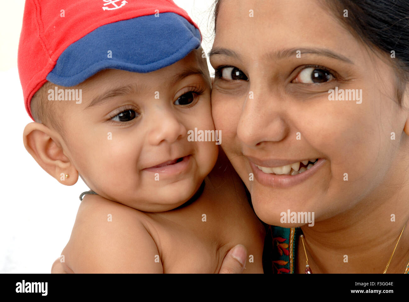Indian mother and baby child cheeks touching on white background - MR#364 - RMM 134436 - Stock Image