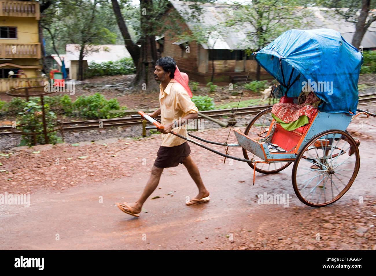 Man driven pulled rickshaw ; Matheran ; Maharashtra ; India - Stock Image