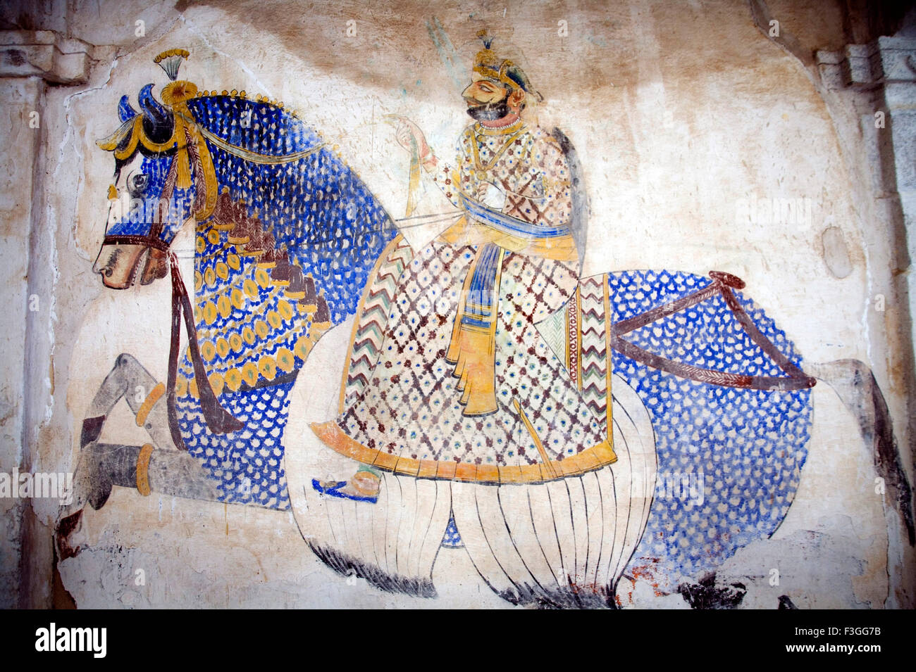 Man riding horse ; Old wall painting in palace hotel ; Devigadh palace ; Village Delwada ; Udaipur ; Rajasthan ; - Stock Image
