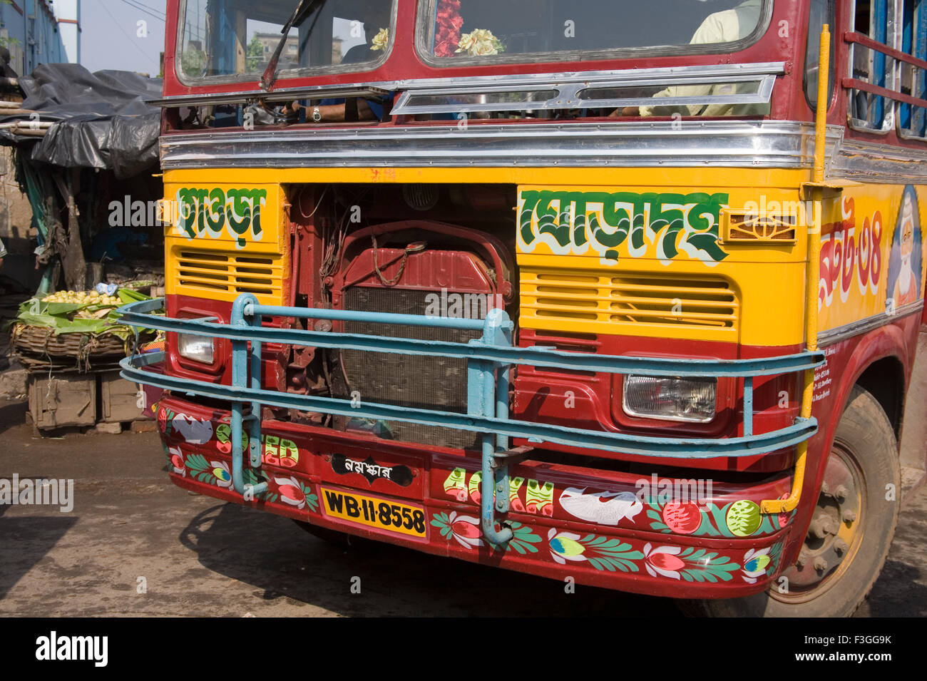 Front panel of local bus written Howrah in Bangla Bengali script ; Calcutta Kolkata ; West Bengal ; India - Stock Image